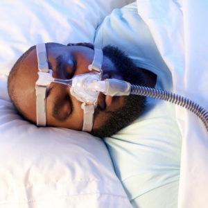 A man with sleep apnea is sleeping.