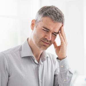A man is having a headache.