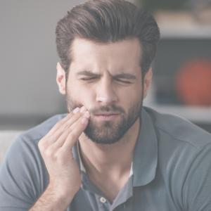 A man is experiencing teeth pain.